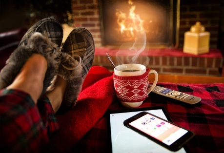 adult beverage breakfast celebration coffee cold comfortable cozy cup drink family fireplace flame food home hot house indoors leisure lifestyle mug people person relax relaxation relaxing resting seat shoes smartphone smoke table tea technology winter